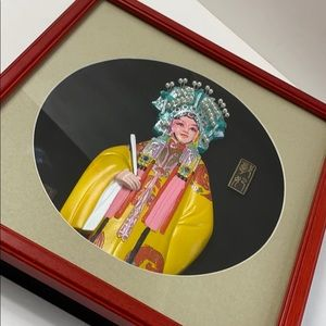 Chinese shadow box depicts the wife of prince Guo